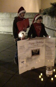 Siblings caroling for a cause.